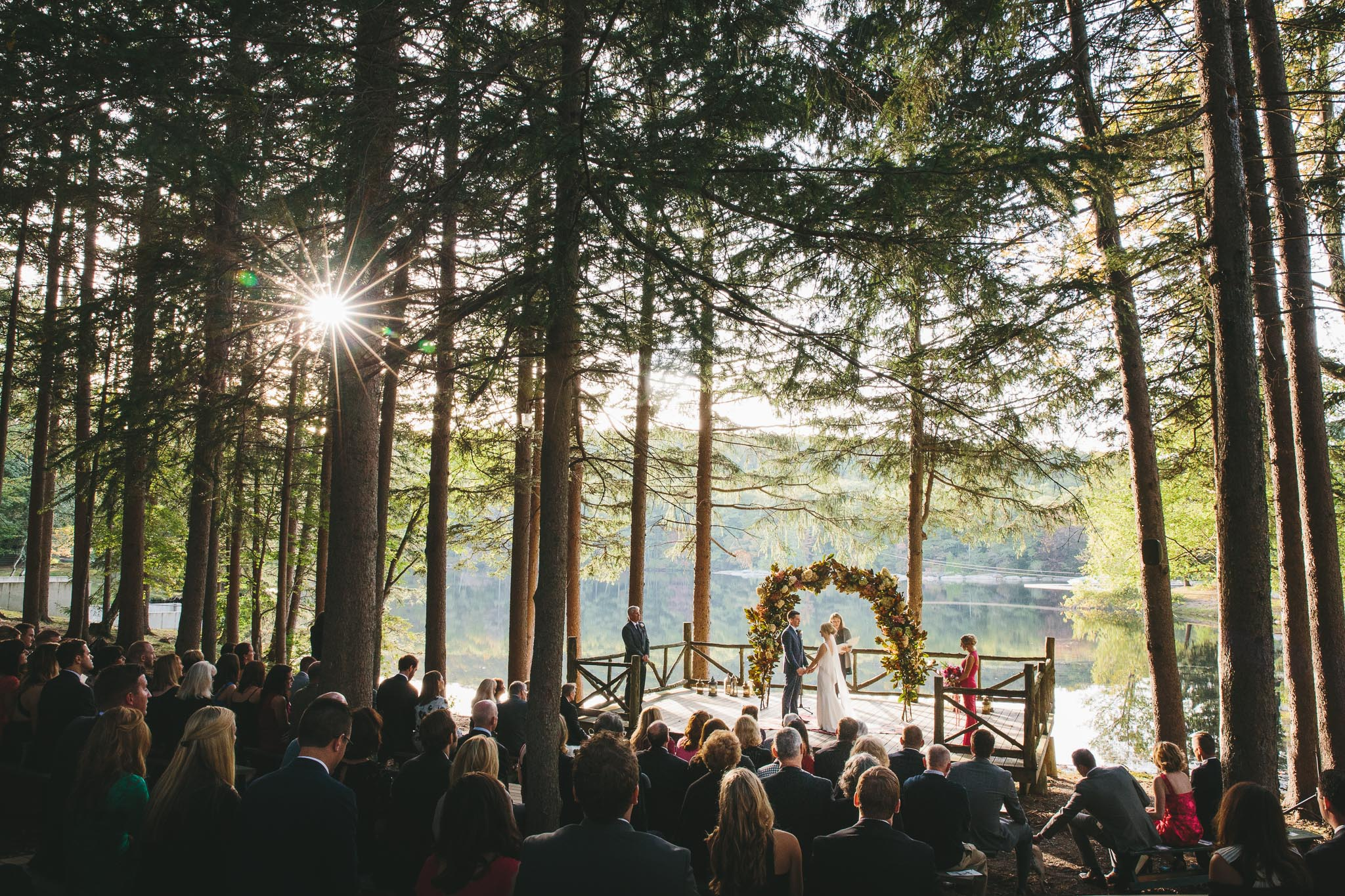 New York Wedding Photographers captured a bride and groom during their atmospheric ceremony at their Cedar Lakes Estate Wedding