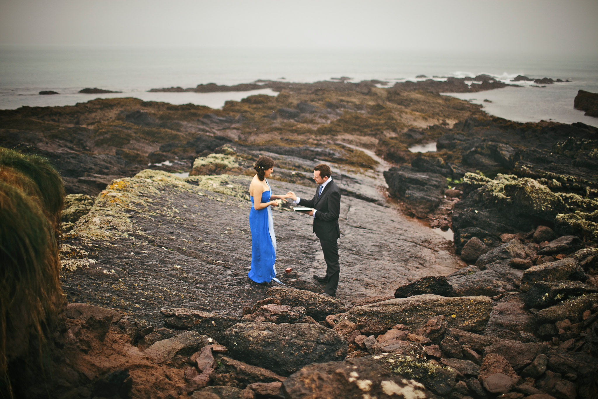 New York Wedding Photographers captured a bride and groom's elopement ceremony on the rocky shores during their Destination Wedding in Dingle, Ireland