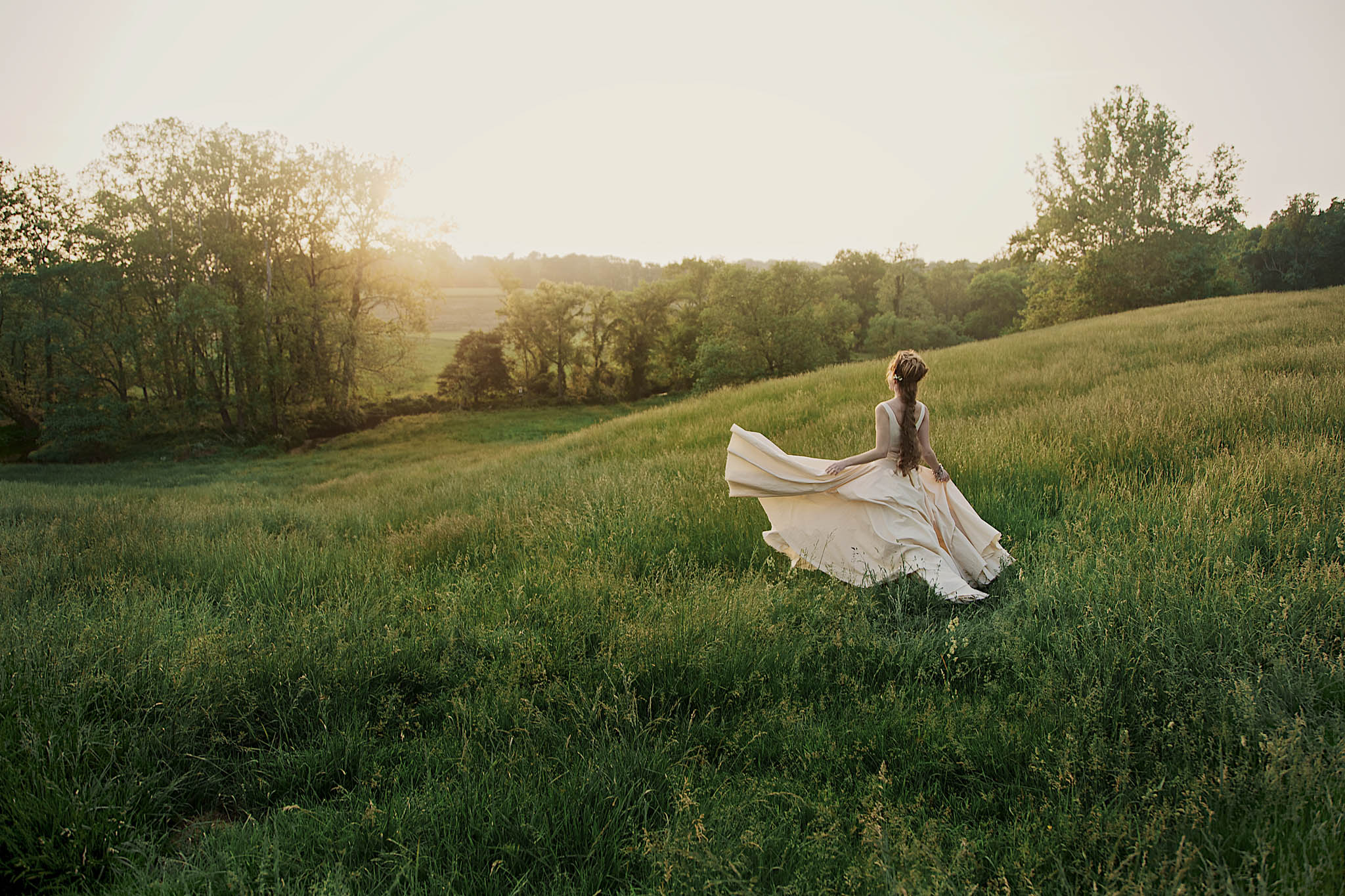 New York Wedding Photographers captured a bride in a field at a Hudson Valley Wedding